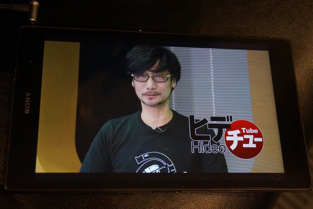 """Checking the video at the airport."" - Kojima"