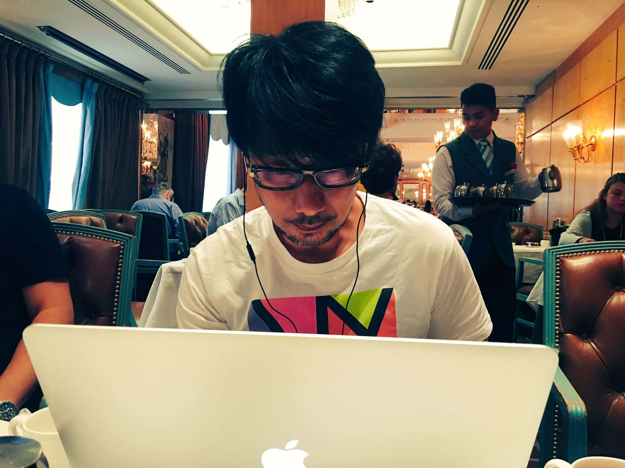 """Good morning from London🇬🇧 Hideo Kojima checking some footage during breakfast."" - Ayako"
